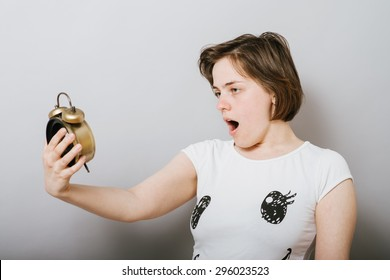 girl looks at the clock