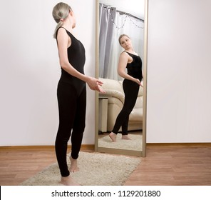 the girl looks at her reflection in the mirror. Think yourself fat. the causes of anorexia and bulimia