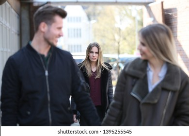 Girl looks jealous at her ex boyfriend and another woman