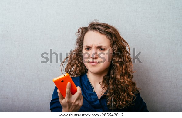 girl looks at mobile