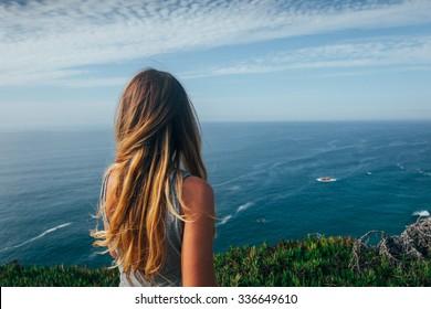 Girl looks on the sea