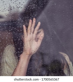 Girl looks at the rain