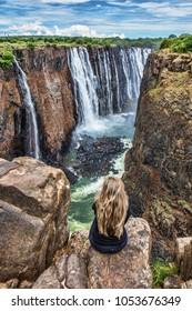 The girl looks at Victoria Falls, Zimbabwe