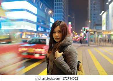 Girl lost in the big city hong kong, stand in middle road at the moment when travel