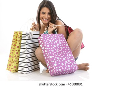 girl with lots of shopping bags