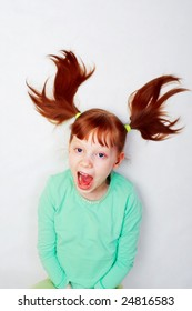 The girl loudly shouts. Photo on a white background.