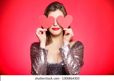 Girl in love dating. Obsession concept. Fall in love. Girl adorable fashion model makeup face hold heart valentines card. Love from first sight. Woman in stylish dress hold symbol love. Romantic mood.