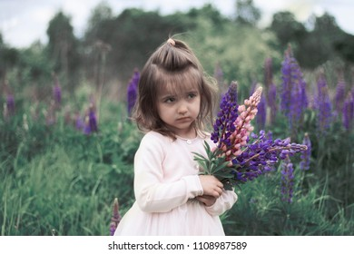 girl with lupin flowers