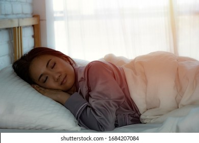 A girl lying in bed on a holiday