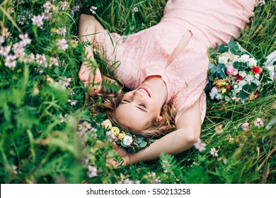 Girl Lying In A Clearing Among White Flowers