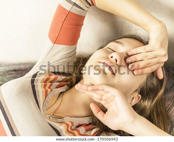 girl lying with closed eyes