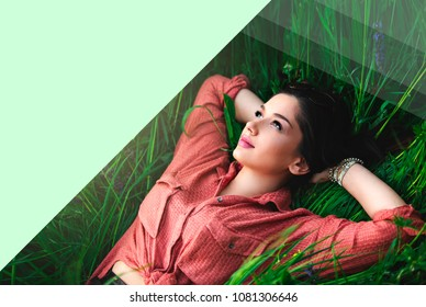 Girl lying in grass with copy-space for text