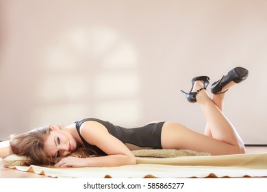 Girl is lying on the bed. Legs crossed.