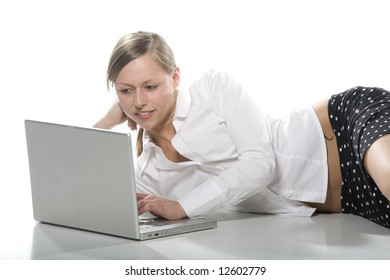 girl lying on the desk in front of the computer