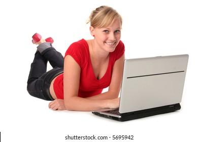 Girl lying on floor using laptop
