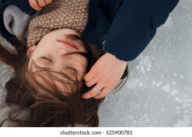 girl lying on the ice