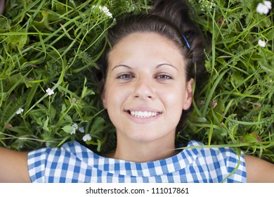 girl lying on a lawn
