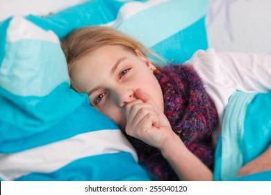 girl lying sick in bed