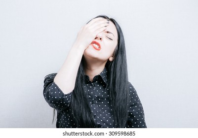 girl made a mistake, covers face with her hands