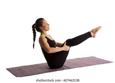 Girl made stretch yoga pilates on the yoga matt isolated