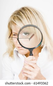 girl with a magnifying glass on a light background