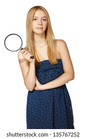 Girl with magnifying glass over white background