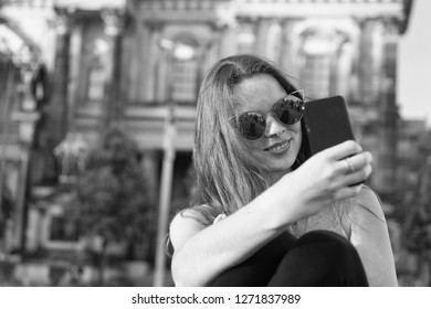 girl make selfie photo on smartphone in germany near berlin cathedral. modern life girl with smartphone. berlin cathedral destination place for tourists. i love selfie. capturing bright moments