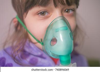 girl makes inhalation on a white background