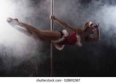 Girl makes pole dance exercise
