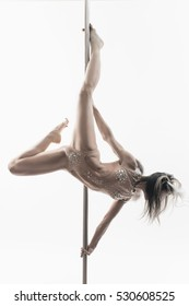 Girl makes pole dance  exercises