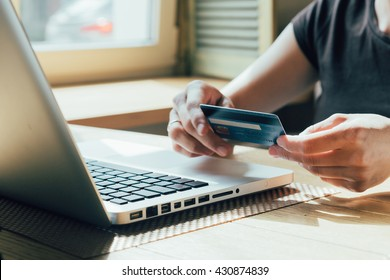 girl makes a purchase on the Internet on the computer with credit card