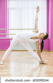 GIrl makes stretching exercises and does yoga