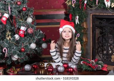 girl makes a wish at Christmas