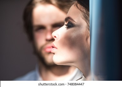 Girl with makeup, eyeshadows, blush, foundation. Woman face profile with blurred man on background. Skin care, treatment, health. Couple of fashion models. Cosmetics, beauty, visage concept.