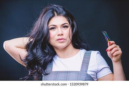 Girl makeup face hold tweezer for eyelash extension. Makeup false lashes volume. Lash applicator. Professional eyelash extension tweezer. Makeup artist. Cosmetic tweezer. Beauty shop concept.