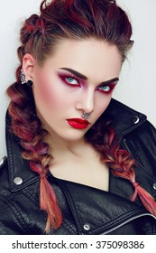 Girl with makeup in a rock style. Piercing.
