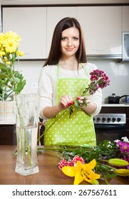 Girl making  beautiful bouquet of flowers cutting