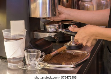 The girl was making coffee.