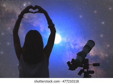 Girl making a heart-shape for the stars with telescope beside her. Elements of this image are only my work.