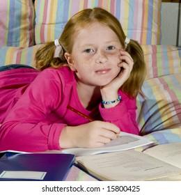 Girl is making homework from school