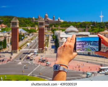 girl making photo with samsung galaxy s7 cell phone from barcelona penthouse