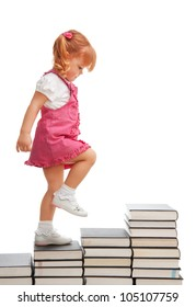 Girl making a step on the stairs made of books, isolated on white