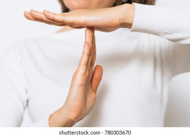 Girl making time out gesture