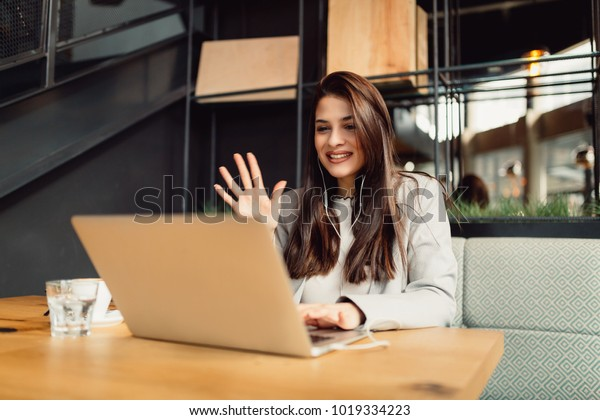 Girl making a video call online on the internet.