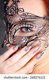 Girl in mask with acrylic manicured beautiful nails