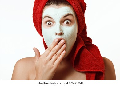 The girl in a mask for the face with a towel on his head
