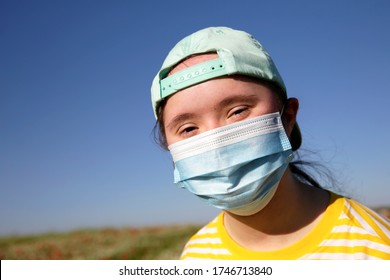 Girl with a mask on her face on background on a blue sky