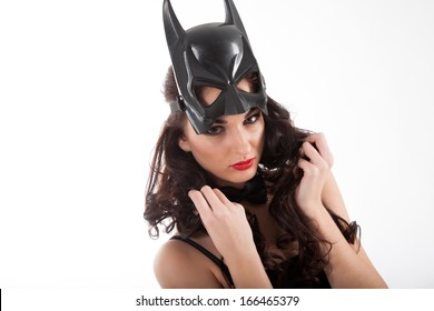 Girl in a mask on a white background