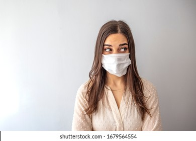 Girl with mask to protect her from Corona virus. Corona virus pandemic. Girl with medical mask to protect her from virus. People hospitalized, diagnosed, in carantine (isolation)