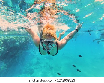 girl in a mask for snorkeling